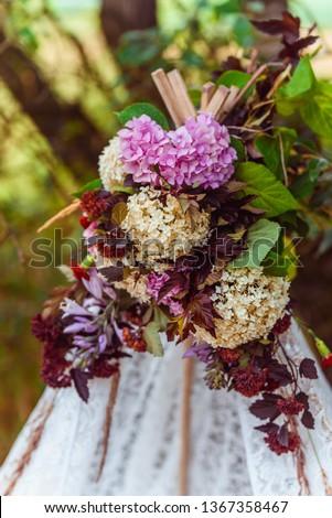 Flower ornamentation outoors on a tipi #1367358467