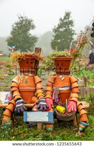 Flower pot men made out of terracotta pots in a garden #1235655643 & Flower-pot-men Images and Stock Photos - Avopix.com