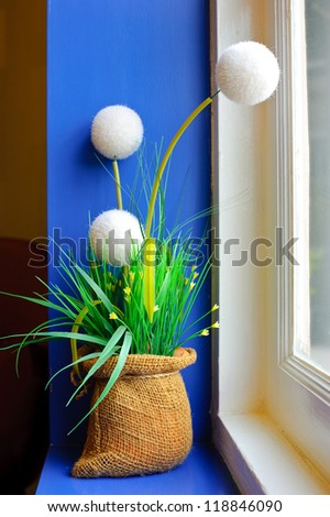 Flower pot on window sill.