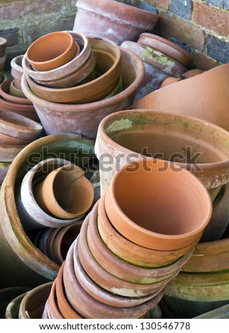 Flower pots; random piles and stacks of vintage flowerpots