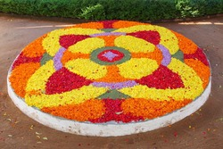 flower rangoli decoration for Onam in Kerala,South India.Shallow depth of field photograph.