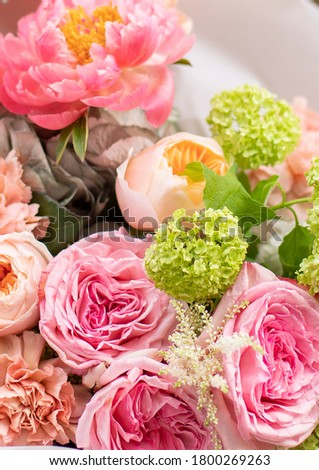 Flower shop. Beautiful bouquet of mixed flowers in man hands. The work of the florist at a flower shop. Delicate bright color. Fresh cut flower. stock photo