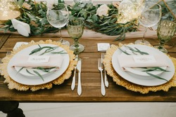 Flower table decorations for holidays and wedding dinner. Table set for holiday, event, party or wedding reception in a restaurant.