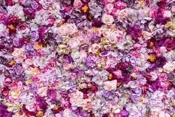 Flower texture background for wedding scene. Roses, peonies and hydrangeas, artificial flowers on the wall.