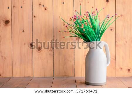 flower vase white on wooden background. #571763491