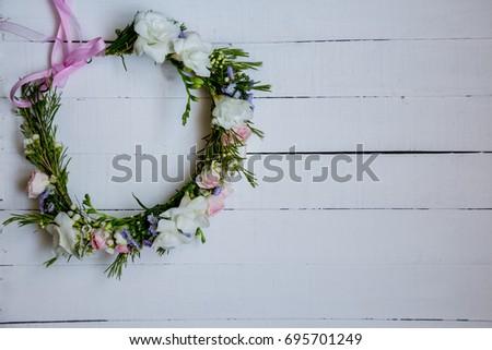 flower wreath on wooden white...