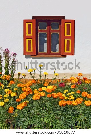 Flowerbed under vintage window in antique village