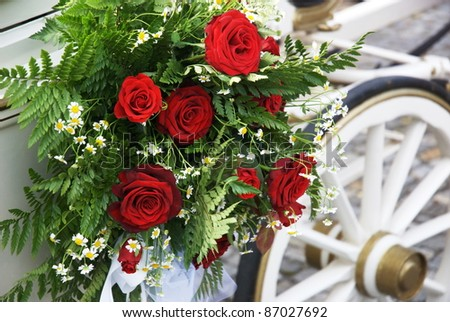 stock photo Flowered wedding carriage with huge bouquet on side