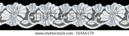flowered  white lace on black background