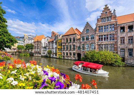 Shutterstock Flowers along a canal in the old town of Ghent, Belgium