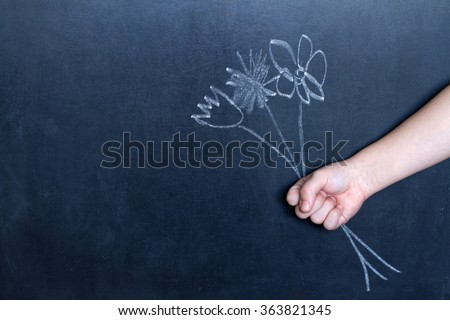 Flowers and child\'s hand abstract background concept