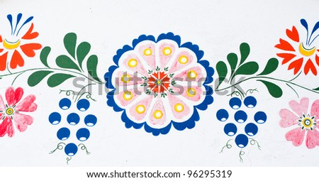 Flowers and grapes: closeup of traditional colorful folk painting on the walls of a wine cellar (Petrov, winemaking region in Southern Moravia, Czech Republic) - stock photo