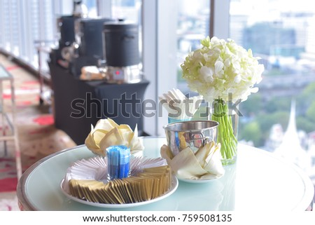 Flowers and hot coffee set on the table.