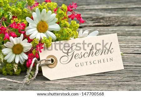 flowers and label with gift card/flowers/gift card