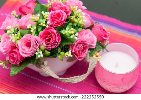 flowers basket. Festive table setting with basket of flowers and candle