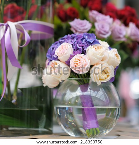 Flowers bouquet in glass vase at the flower shop