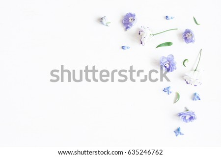 Stock Photo Flowers composition. Border made of lilac and white flowers. Flat lay, top view