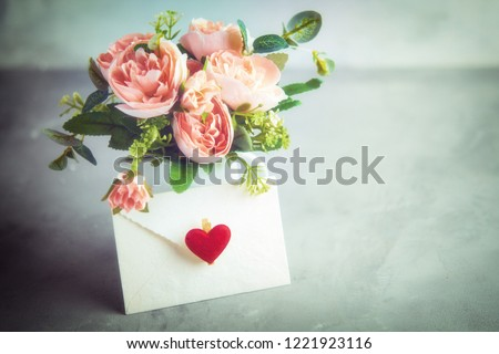 Photo of Flowers composition for Valentine's, Mother's or Women's Day. Still-life. Romantic soft gentle artistic image, free space for text. selective soft focus, blurred background.