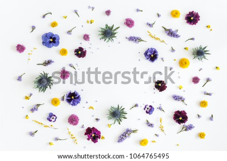 Flowers composition. Frame made of colorful flowers on gray background. Flat lay, top view, copy space
