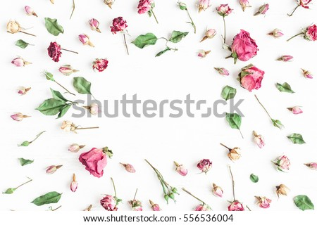 Flowers composition. Frame made of dried rose flowers on white background. Flat lay, top view.