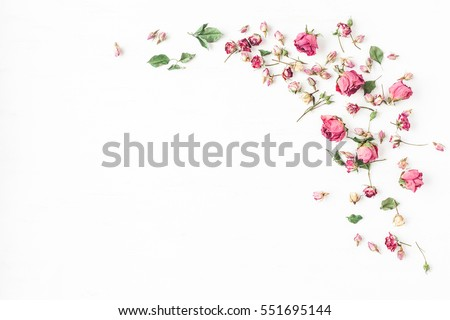 Photo of Flowers composition. Frame made of dried rose flowers on white background. Flat lay, top view, copy space
