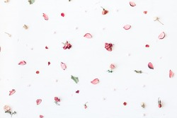 Flowers composition. Frame made of pink dried flowers and leaves on white background. Top view, flat lay, copy space