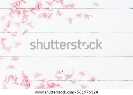 Flowers composition. Frame made of pink flowers on wooden white background. Valentine's Day. Flat lay, top view
