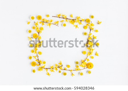 Flowers composition. Frame made of various yellow flowers on white background. Easter, spring, summer concept. Flat lay, top view #594028346
