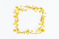 Flowers composition. Frame made of various yellow flowers on white background. Flat lay, top view