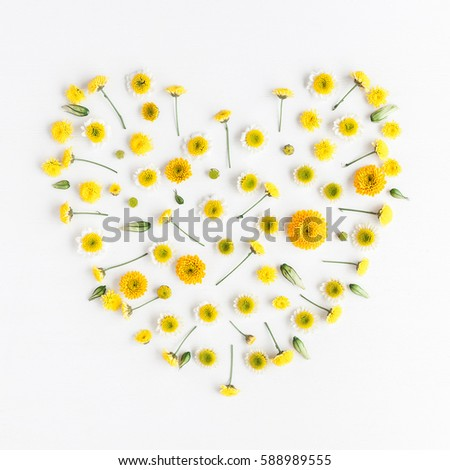 Flowers composition. Heart symbol made of various yellow flowers on white background. Easter, spring, summer concept. Flat lay, top view - Shutterstock ID 588989555