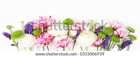 Flowers composition made of ranunculus, chrysanthemum and other flowers on white background. Flat lay, top view. #1033006939