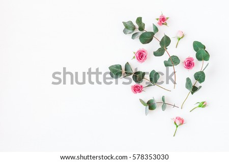 Flowers composition made of rose flowers and eucalyptus branches. Mock up with flowers. Flat lay, top view.