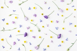 Flowers composition. Pattern made of various colorful flowers on white background. Easter, spring, summer concept. Flat lay, top view
