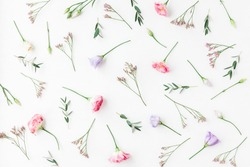 Flowers composition. Pattern made of various flowers and eucalyptus branches on white background. Flat lay, top view