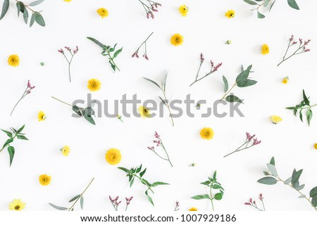 Flowers composition. Pattern made of yellow and pink flowers on white background. Flat lay, top view.