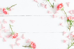 Flowers composition. Pink flowers on white wooden background. Valentine's Day. Flat lay, top view, copy space
