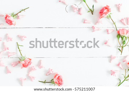 Flowers composition. Pink flowers on white wooden background. Valentine's Day. Flat lay, top view.