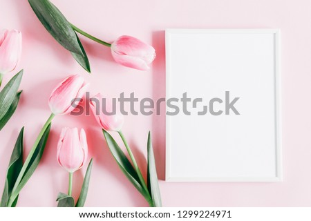 Flowers composition romantic. Flowers pink tulips, photo frame on pastel pink background. Wedding. Birthday. Happy woman's day. Mothers Day. Valentine's Day. Flat lay, top view, copy space