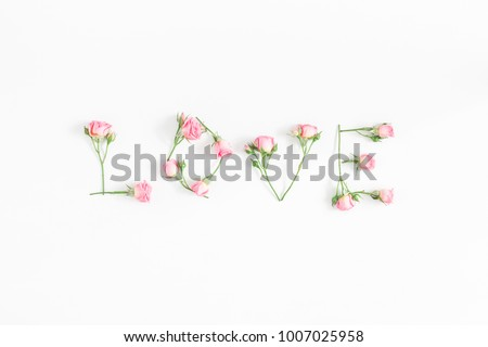 Flowers composition. Word love made of pink rose flowers on white background. Flat lay, top view. #1007025958