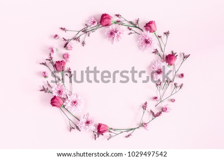Photo of Flowers composition. Wreath made of pink flowers on pink background. Flat lay, top view, copy space
