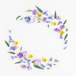 Flowers composition. Wreath made of various colorful flowers on white background. Easter, spring, summer concept. Flat lay, top view, copy space