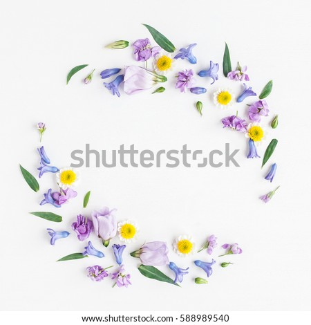 Flowers composition. Wreath made of various colorful flowers on white background. Easter, spring, summer concept. Flat lay, top view, copy space #588989540