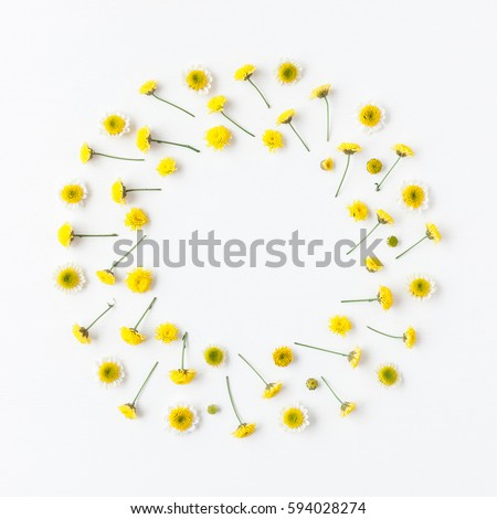 Flowers composition. Wreath made of various yellow flowers on white background. Easter, spring, summer concept. Flat lay, top view - Shutterstock ID 594028274