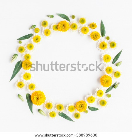 Flowers composition. Wreath made of various yellow flowers on white background. Spring, summer, easter concept. Flat lay, top view