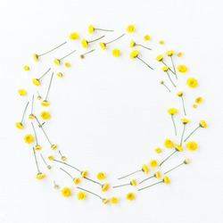 Flowers composition. Wreath made of yellow flowers on white background. Flat lay, top view, copy space