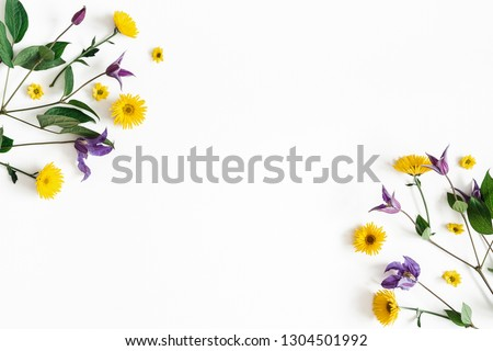 Flowers composition. Yellow and purple flowers on white background. Spring, easter concept. Flat lay, top view, copy space #1304501992