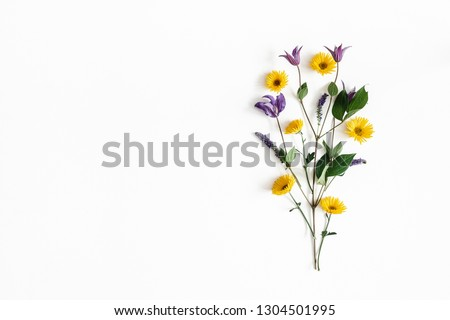 Flowers composition. Yellow and purple flowers on white background. Spring, easter concept. Flat lay, top view, copy space #1304501995