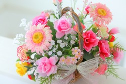 Flowers decorated in a basket with gratitude