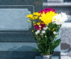 Flowers displayed in flower stands and Japanese graves.