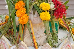 Flowers for Baby Buddha. Thai people make a gifts of fresh Flowers for Buddha statues in the Temples. Buddhist Art in Thailand. Artistic manifestation of Buddhism.